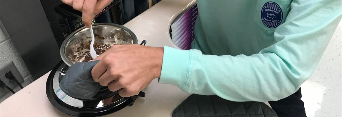 High school students  put their dimensional analysis and scientific notation skills to the test by converting a fudge recipe into the correct units and actually made their own individual serving of fudge.