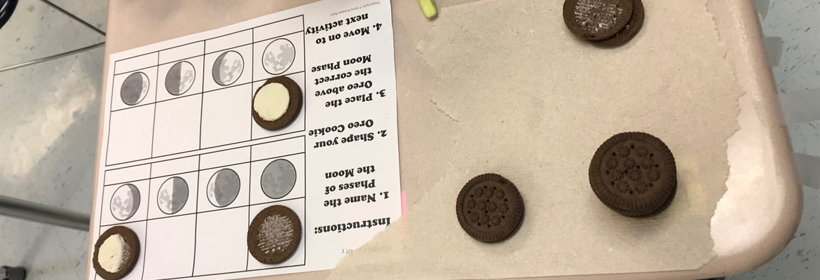 Middle school DTC and AEC students used Oreos to represent the different phases of the moon.